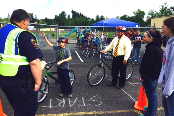 Volunteers hold bike safety program at Winlock Miller Elementary School