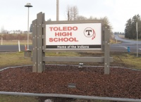 Boy Scouts, volunteers install new Toledo HS sign during break