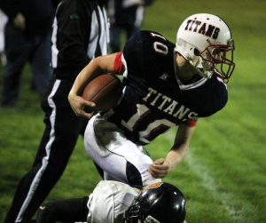 Titans blast past Mountaineers 36-0