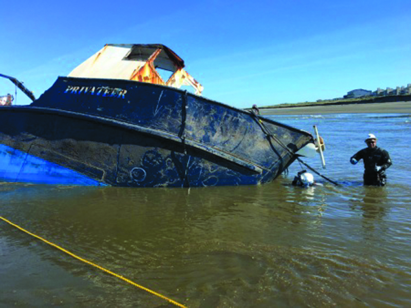 Privateer near North Jetty aided by low tide