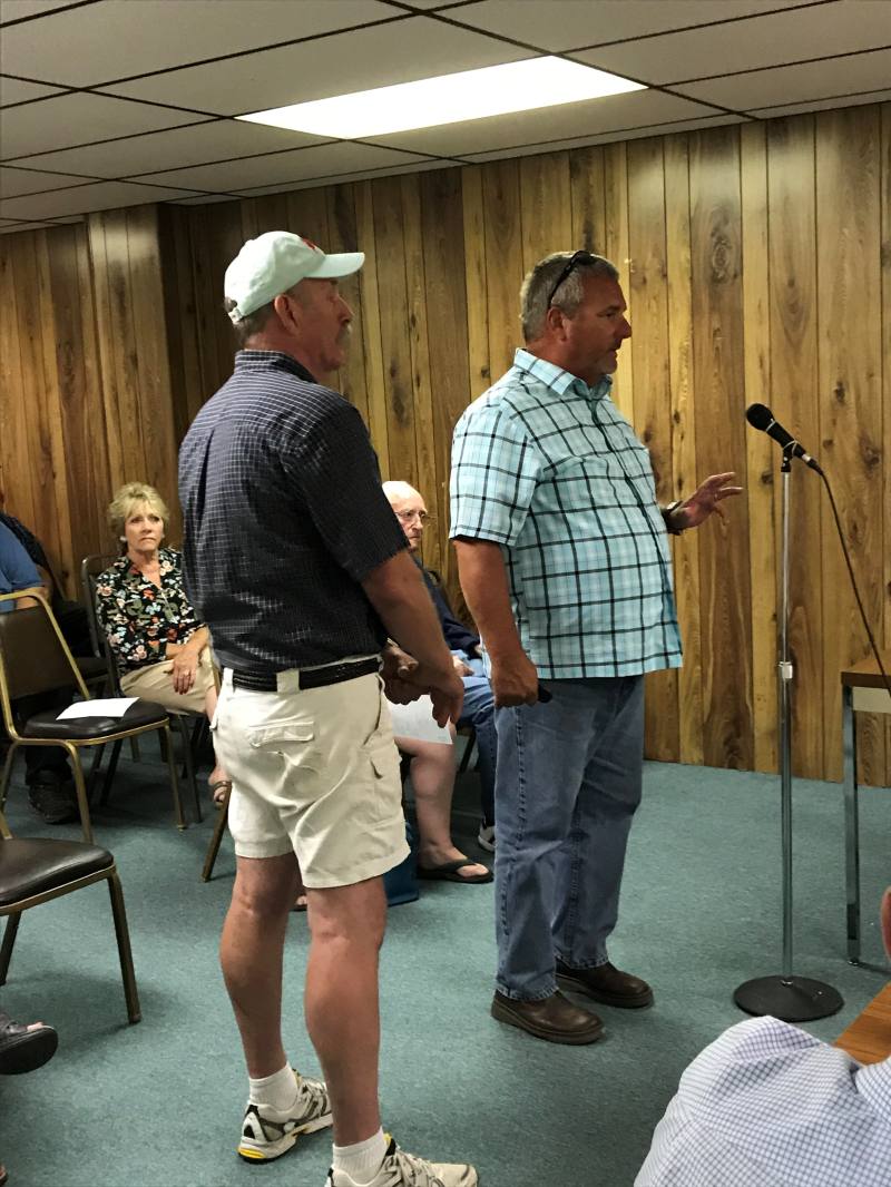 Photo by Lynnette Hoffman - Jim Henderson, President of the Lewis County Senior Board and Bobby Jackson, County Commissioner speak to the Winlock City Council about ownership of the Olequa Senior Center during Monday's city council meeting.