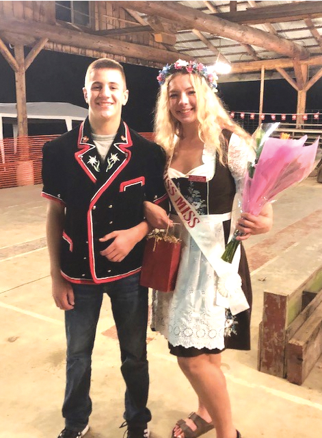 Escort Tyson Portmann with newly crowned 2021-22 Lewis Pacific Swiss Society Swiss Miss Alli Engel.