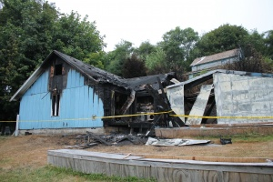 Total loss on house fire; man rescued in mud