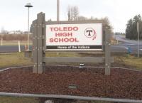 Boy Scouts, volunteers install new Toledo HS sign during break