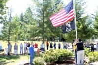 Ryderwood dedicates new flagpole, retires old emblems