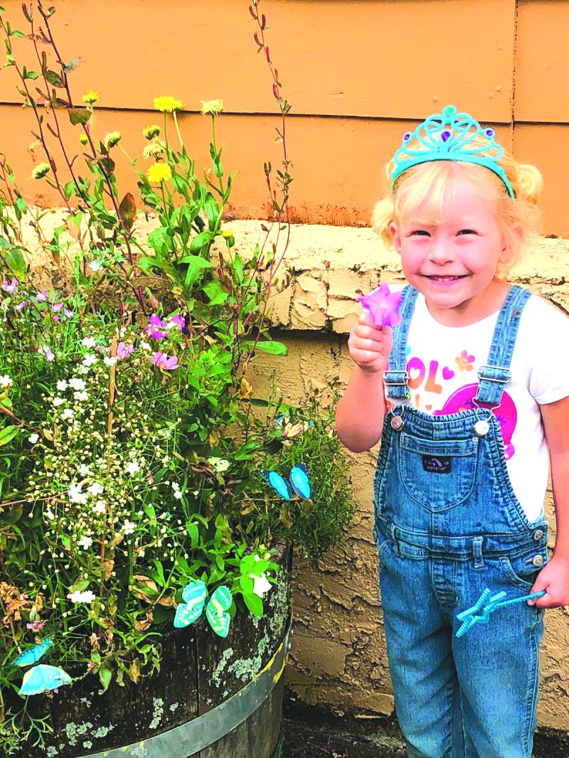 Little gardener growing beautiful flowers