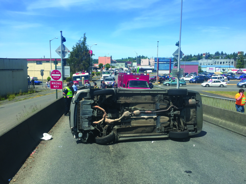 Simpson Avenue bridge roll over vehicle collision